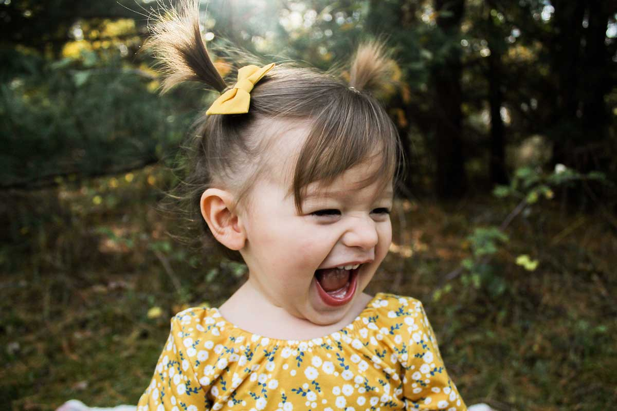 Young girl with baby teeth laughing