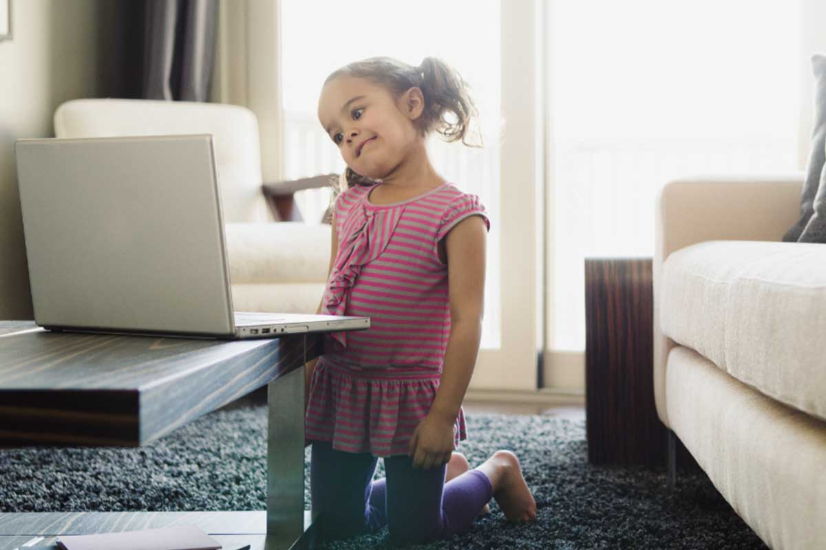 Young girl confused looking at laptop